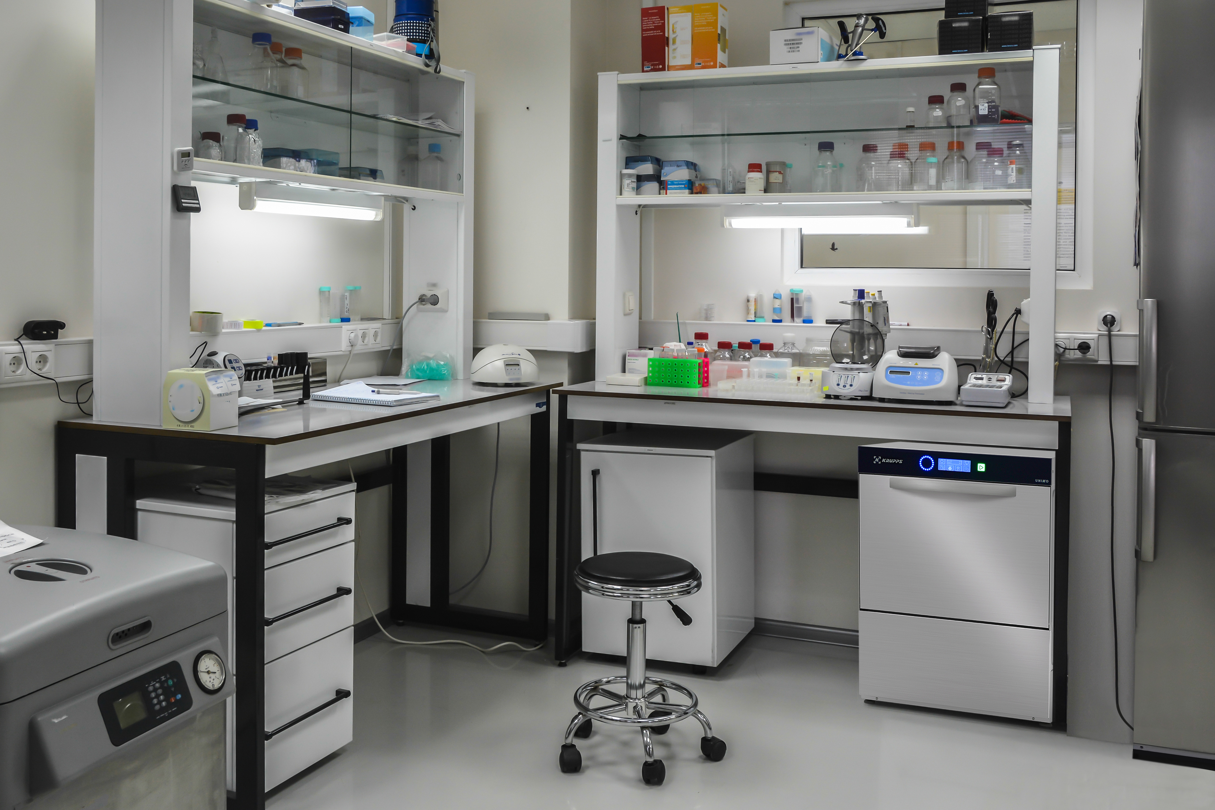 The interior of a modern biological laboratory. Equipment and furniture in the room for scientific research.
