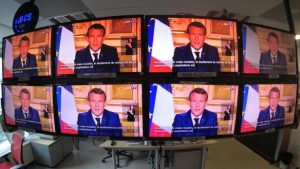 </span></figure></a> <em>French President Emmanuel Macron is seen as he addresses the nation about the coronavirus disease (COVID-19) outbreak, on television screens in Paris, France, April 13, 2020. REUTERS/Charles Platiau</em>