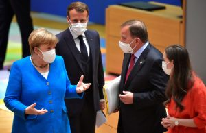 </span></figure></a> German Chancellor Angela Merkel gestures next to France's President Emmanuel Macron, Sweden's Prime Minister Stefan Lofven and Finland's Prime Minister Sanna Marin during the first face-to-face EU summit since the coronavirus disease (COVID-19) outbreak, in Brussels, Belgium July 18, 2020. John Thys/Pool via REUTERS