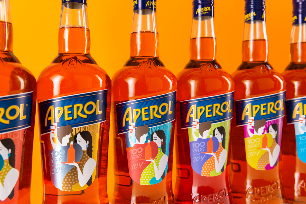 aperol_pr_100yearslabel_6bottles_orangebackground