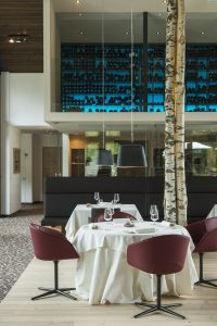 </span></figure></a> Detail of the dining room and the red wine cellar at Auener Hof Luxury Gourmet Resort,Sarntal Valley
