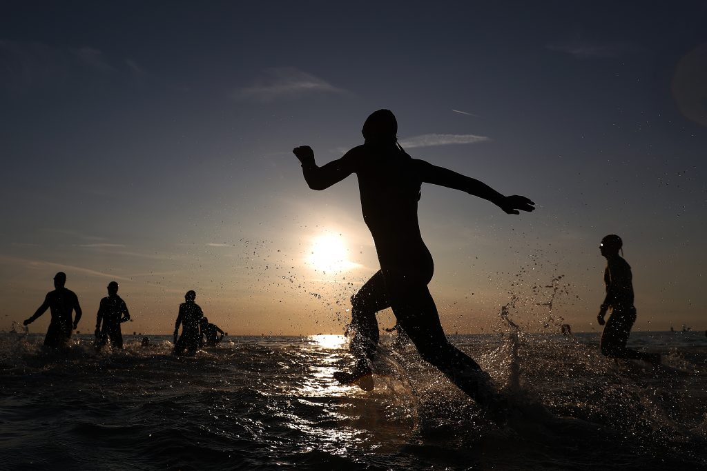 </span></figure></a> The Start (Photo by Bryn Lennon/Getty Images for IRONMAN)