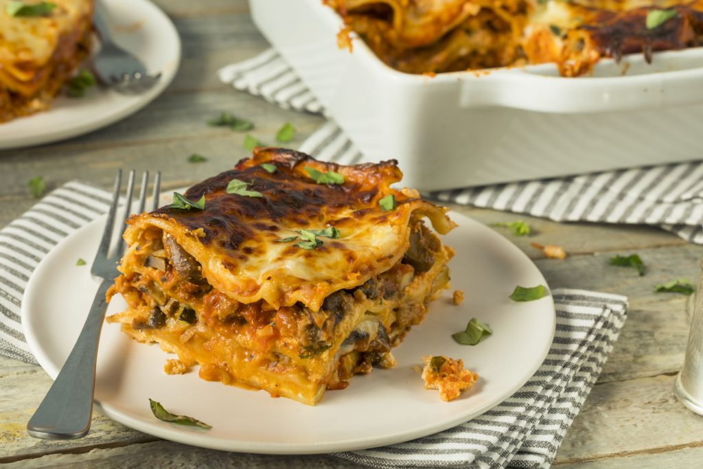 91128844 - savory homemade italian beef lasagna with cheese and sauce